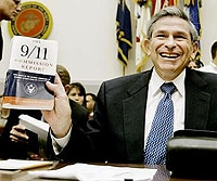 Photo of Wolfowitz holding the 9/11 Commission Report