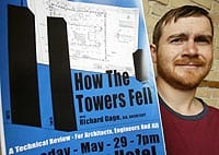 Joe Hawkins holds a poster for a 9/11 event